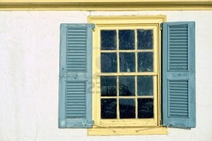 10266459-old-antique-window-with-leaded-glass-panes-and-vintage-wood-shutters-on-a-historic-home-colonial-bui